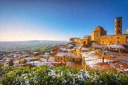 Volterra snowy town in winter at sunset. Pisa province, Tuscany, Italy, Europe.