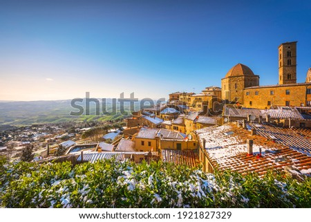 Volterra snowy town in winter at sunset. Pisa province, Tuscany, Italy, Europe. ストックフォト ©