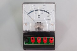 Voltmeter is used to measure DC voltage. The device is a mobile coil type in a scientific laboratory.