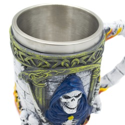 Volumetric beer mug depicting skulls and death with a scythe.