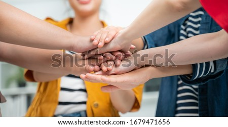 Volunteer charity work join hand together concept.Business friend colleagues hand join together for successful business achievement,cooperation success.businesspeople partners hand join for success.