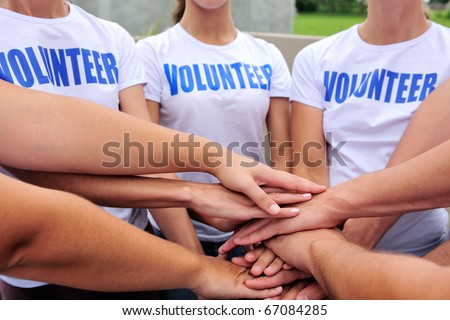 volunteer group hands together showing unity - stock photo