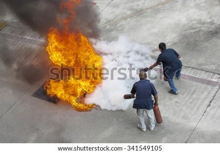 volunteer try to extinguish the ...