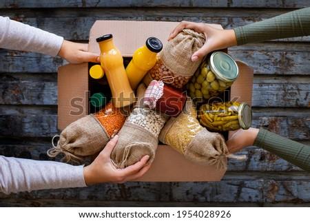 Volunteer with box of food for poor . Ramazan kolisi . Donation concept
