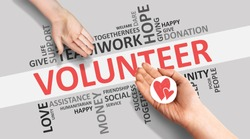 Volunteering And Charity. Hands Giving Picture Of Heart On Volunteer Wordcloud White Background With Words. Panorama