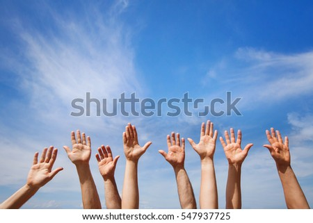 volunteering concept, hands of group of people volunteers in blue sky
