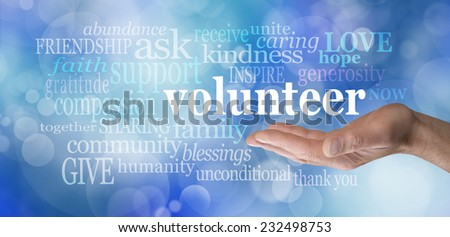 Volunteers needed hand gesture on blue bokeh  -  Male hand palm up with the word \'volunteer\' floating above surrounded by relevant words on a blue bokeh background