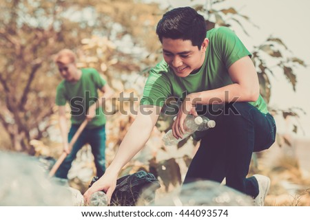 Volunteers picking up litter in the park