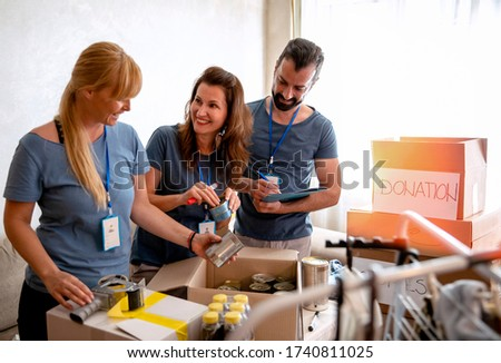 Volunteers working in charitable foundation Warehouse on helping homeless people.Social workers who provide humanitarian assistance to a disadvantaged person Stock fotó ©