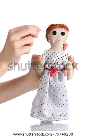 Voodoo doll girl in the hands of women isolated on white
