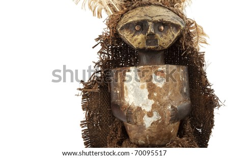 Voodoo doll, old, dirty, African and soiled with smoke isolated on white background