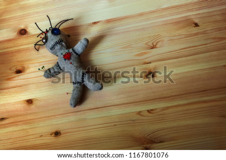 Voodoo Doll on wooden background #1167801076