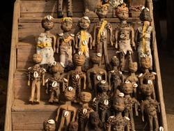 Voodoo dolls of different size and type sold by local people at the Akodessewa Voodoo Fetish market. Togo, Africa.