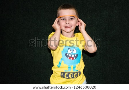 Voronezh, Russia, June 2018: Portrait of a cheerful boy, at a children's holiday #1246538020