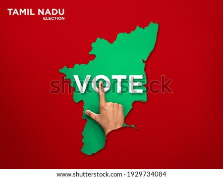 VOTE FOR INDIA TAMIL NADU, male Indian Voter Hand with voting sign or ink pointing out , Voting sign on finger tip Indian Voting on red background Zdjęcia stock ©