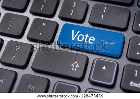 vote or voting concepts, through computer or internet, with a message on enter key of keyboard. - stock photo