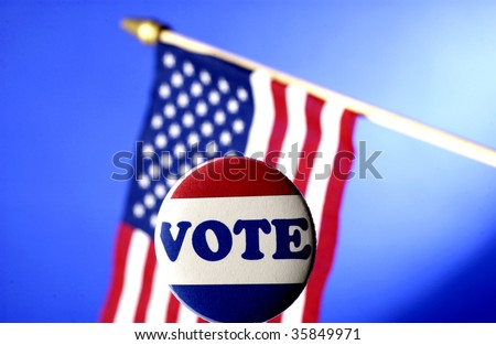 vote pin in front of American flag