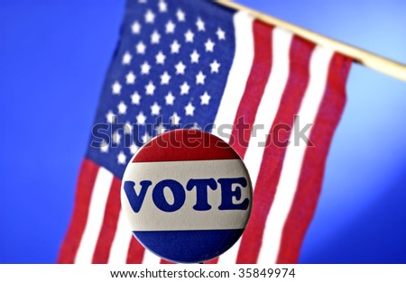 vote pin in front of American flag - stock photo
