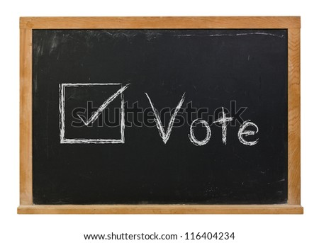Vote written in white chalk on a black chalkboard isolated on white