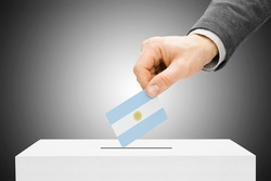 Voting concept - Male inserting flag into ballot box - Argentina