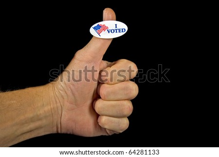 voting sticker on man's thumb