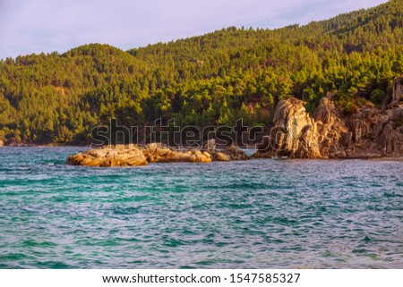 Vourvourou, Chalkidiki or Halkidiki, Greece summer scenery with sea, forest mountains and rocks at Fava beach