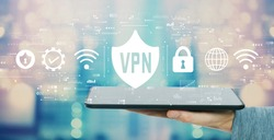 VPN concept with man holding a tablet computer