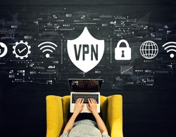 VPN concept with person using a laptop in a chair