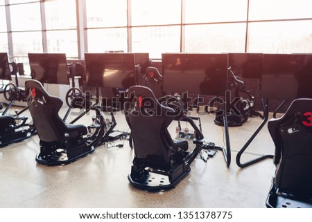 VR games. Virtual reality videogame race simulator. Empty gaming room in shopping center.