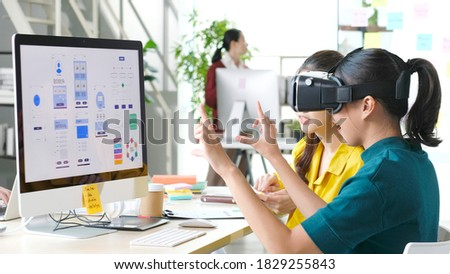 VR mobile phone application test, Asian woman with virtual reality glasses headset in VR experience, Asia business team developers for reality simulator smartphone app test at creative office, ui
