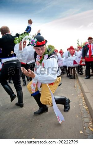 VRACOV - OCTOBER 15: People in folk costume dance Verbunk on The biggest folk feast in Czech Republic, Oct 15, 2011 in Vracov, Czech Republic. Feast Vracov - stock photo