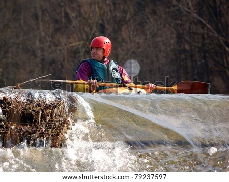 VSETIN, CZECH REPUBLIC - MARCH 10: Unidentified kayaker runs the river of Becva during the Spring Open River Festival, March 10, 2007 in Vsetin, Czech republic.
