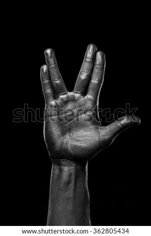 Vulcan salute. Black hand.