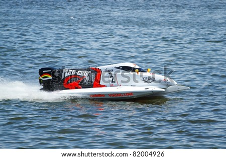 VYSHGOROD, UKRAINE -  JULY 29 : Powerboat number 2 Team of Mad Croc F1 fast speed.  Grand Prix Formula 1 H2O World Championship Powerboat on July 29, 2011 in Vyshgorod, Ukraine .