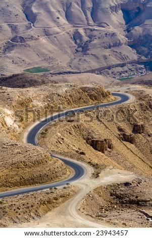 Wadi Mujib - King 's road area, curvy highway with desert landscape in Jordan.