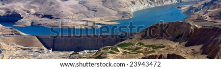 Wadi Mujib - King 's road area, highway  on the water dam with desert landscape around it in Jordan.