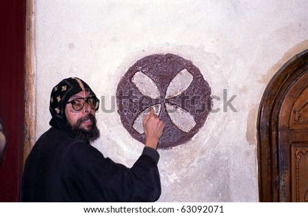 WADI NATRUN, EGYPT - NOVEMBER 28 : Coptic monk teaches religious symbols at 28 November, 1998 in Wadi Natrun, Egypt. Coptic is an ancient Christian religion remained in Egypt during centuries.