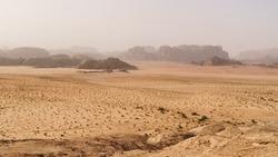 Wadi Rum desert, Jordan. Designation as a UNESCO World Heritage Site. National park outdoors landscape. Offroad adventures travel background. Haze wheather.