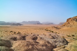 Wadi Rum desert, Jordan, The Valley of the Moon. Orange sand, haze. Designation as a UNESCO World Heritage Site. National park outdoors landscape. Offroad adventures travel top view background.