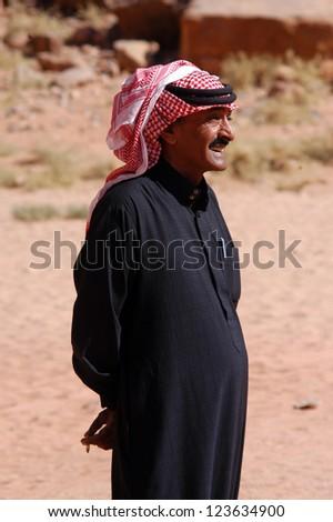 WADI RUM, JORDAN - NOV 10 2007:Jordanian Arab man wearing red Keffiyeh in Wadi Rum Jordan.It has been used by Arabs throughout the centuries and was used as symbol of honor and tribal identification.