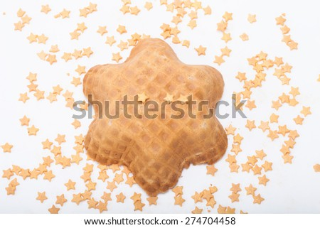 Wafer and pastry decoration stars on a light background. Selective focus.