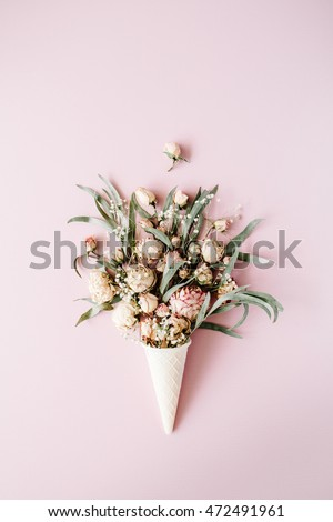 waffle cone with roses bouquet on pink background, flat lay, top view #472491961