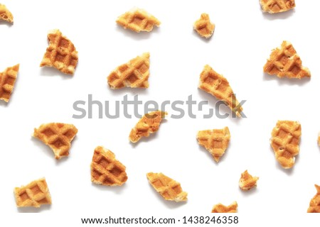 Waffle texture. Wafer cone pieces isolated on white background. Сток-фото ©