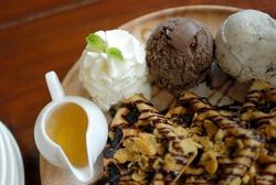 Waffle with chocolate cream and ice cream