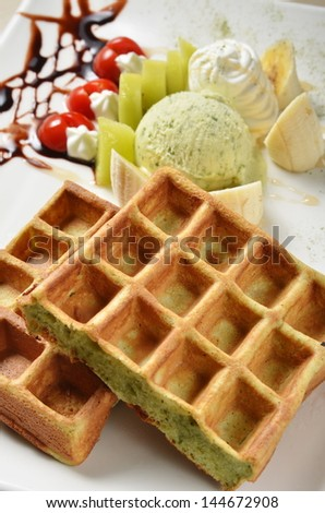 Waffle with ice cream on plate