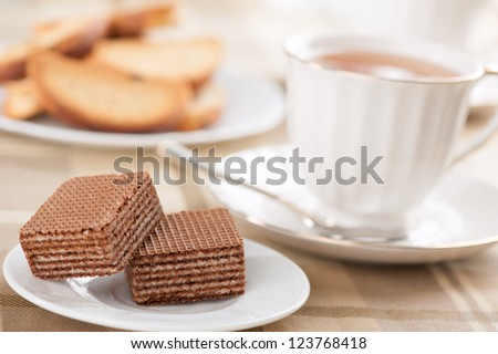 waffles and cup of tea on a table