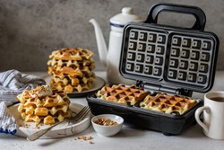 Waffles Being Baked in the Waffle Maker, square