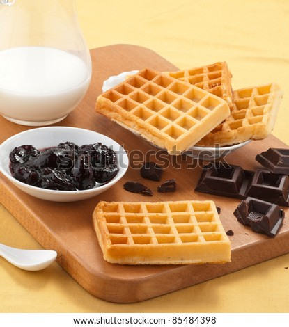 Waffles , jam , chocolate and milk - stock photo