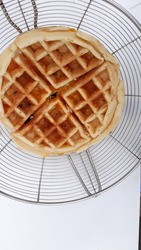 Waffles out of the oven that everyone will be thrilled with. Waffle with fresh raisins with curry paste on white background.