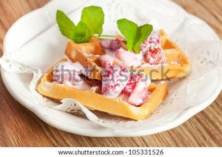 waffles with cream,  strawberries and mint